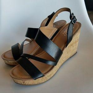 Franco Sarto Cooper black leather wedge heels
